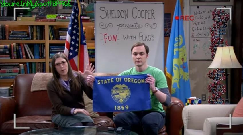 Amy und Sheldon präsentieren die Flagge Oregons